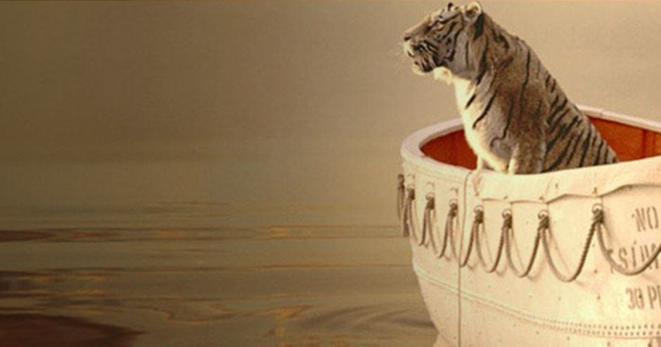 A tiger sitting inside a boat and gazing at the sky, as depicted in Life of Pi